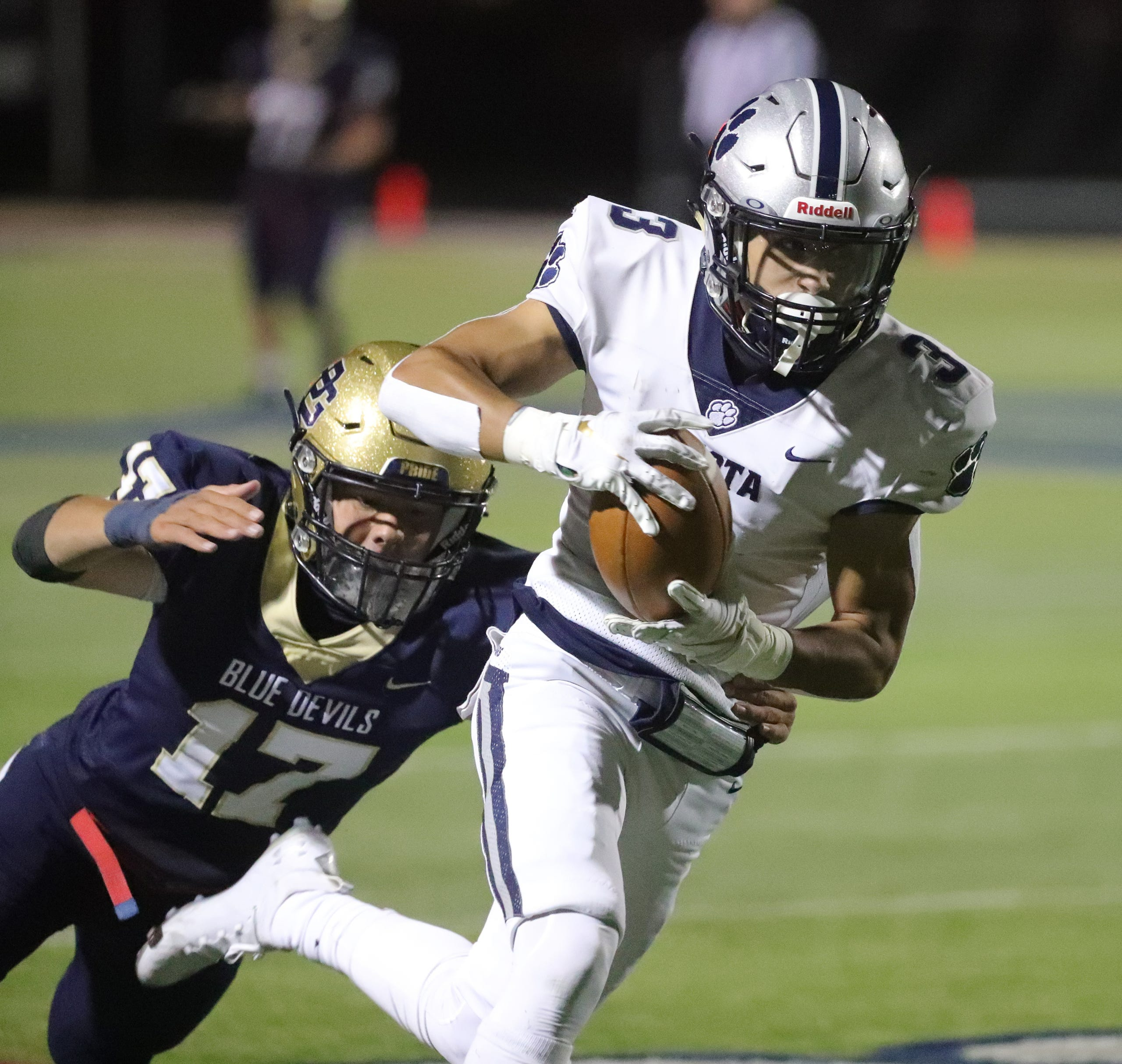 Macomb Dakota receiver Leon Preston makes a catch against Pointe South defender Max Gavagan during the second half at Grosse Pointe South high school Friday, Oct. 2, 2020.
