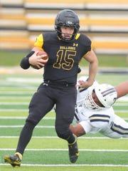 Adrian College quarterback Jack Wurzer runs by Trine University linebacker Tony Nikodemski, Saturday, October 3, 2020 at Docking Stadium in Adrian, Michigan.
