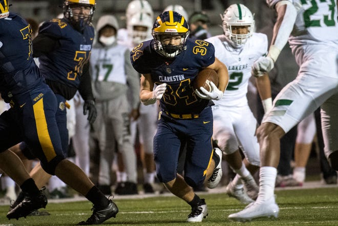 Clarkston sophomore running back Ethan Clark (34) runs the ball during a game Oct. 2.