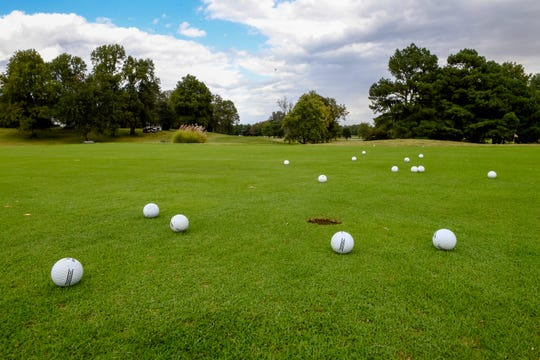 Golf balls on the practice green at the Henderson County Golf Course Friday. The 142-acre 18-hole course has been sold to Charles Morris, one of its members, October 1, 2020.
