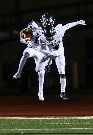 Visiting Trinity had several touchdowns against St. X to celebrate as the Shamrocks dominated the Tigers 48-10 at Brother Thomas More Stadium Friday night. Oct. 2, 2020