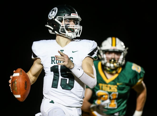 Trinity quarterback Nathan McElroy gets chased by St. X's Ben Green in the second half. The Shamrocks are now 3-0 and Kentucky's No.1 6A team. Oct. 2, 2020