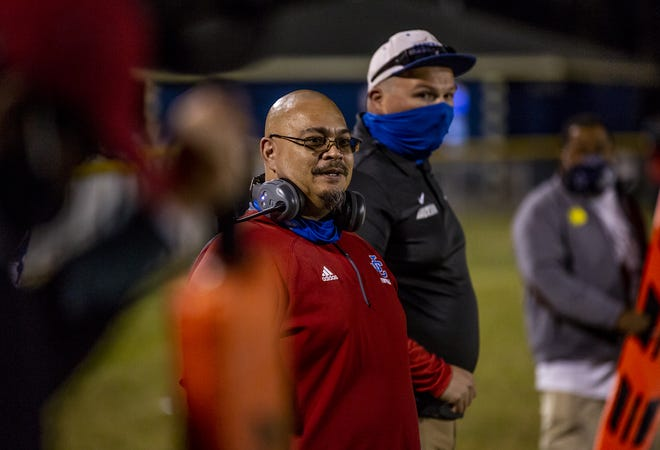 Jackson County head coach John Hallock watched as his team moved downfield against Shawnee on Friday night. Oct. 2, 2020