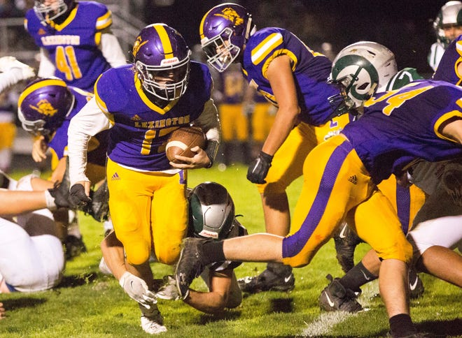 Lexington's Corbin Green races toward the goal line during the Minutemen's win over Madison on Friday.