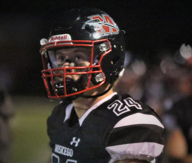 Muskego safety Hunter Wohler looks up at the scoreboard during a game against Waukesha West on October 2, 2020.