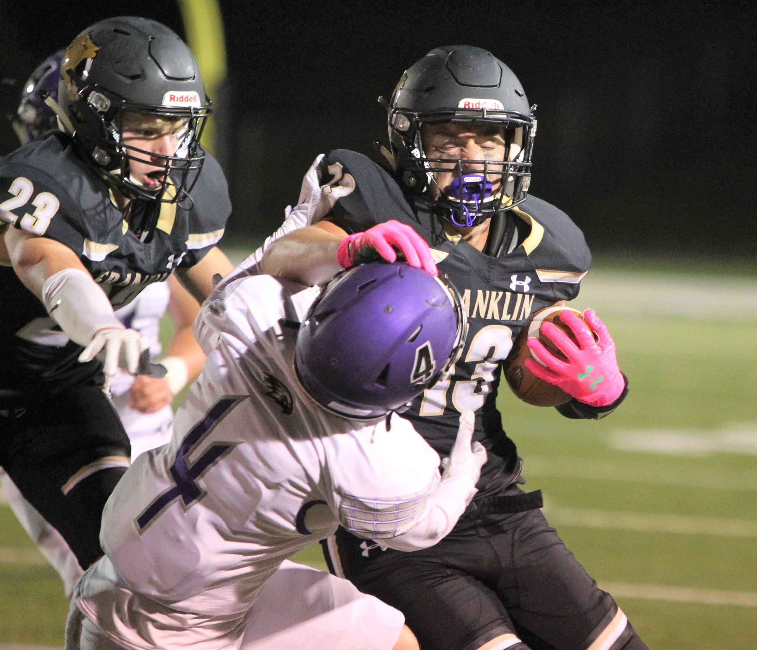 Franklin's Marko Rajkovic stiff-arms Kenosha Indian Trail's Connor Koch during Franklin's 28-6 victory on Friday, Oct. 2, 2020, at Franklin High School.