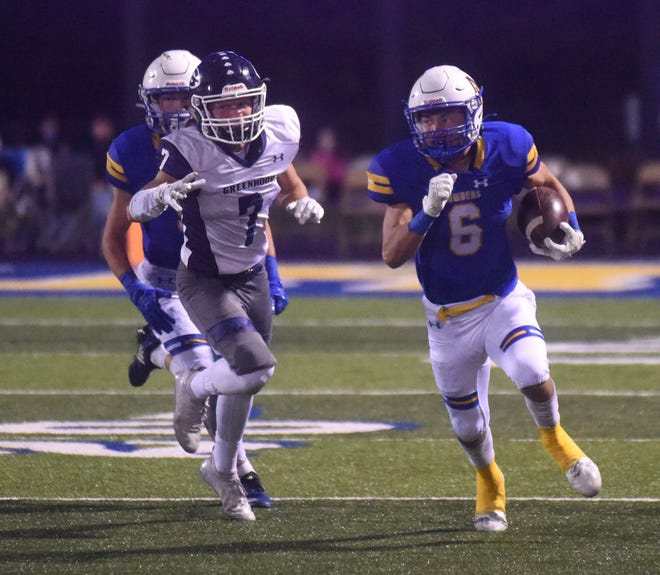 Mountain Home's Logen Walker returns a kick during the Bombers' loss to Greenwood on Friday night.