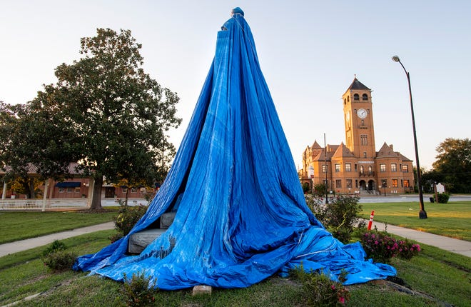 The now covered confederate monument in front of the Macon County Courthouse in Tuskegee, Ala., on Friday October 2, 2020.