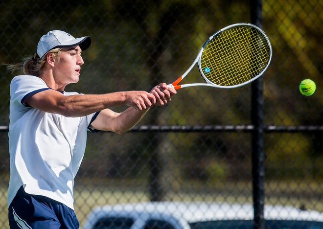 FILE -- Delta's Tanner Southerland faces off against Burris' Charles Behrman during their sectional championship match at Delta High School Saturday, Oct. 3, 2020.
