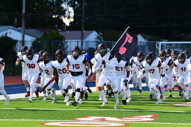 Churchill football charges on to the field.
