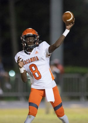 Rennie Prim Jr. (8) passes the ball during the Escambia vs Washington football game at Booker T. Washington High School in Pensacola on Friday, Oct. 2, 2020.