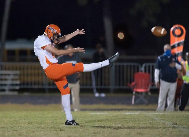 Ethan Yuska (16) punts the ball during the Escambia vs Washington football game at Booker T. Washington High School in Pensacola on Friday, Oct. 2, 2020.