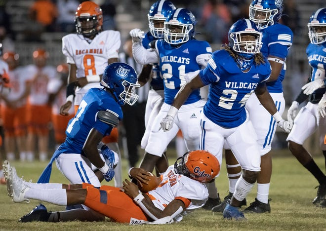 Eldrick Robinson II (24) celebrates after a big stop during the Escambia vs Washington football game at Booker T. Washington High School in Pensacola on Friday, Oct. 2, 2020.