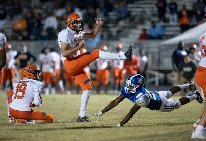 Ethan Yuska (16) adds the extra point as the Gators take a 28-20 lead during the Escambia vs Washington football game at Booker T. Washington High School in Pensacola on Friday, Oct. 2, 2020.