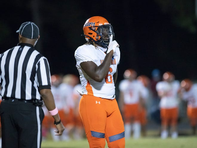 Tabari Taylor (6) shushes the Wildcats sideline after Shawn Blackwell (29)'s pick-6 and a 14-13 lead (after adding the extra point) during the Escambia vs Washington football game at Booker T. Washington High School in Pensacola on Friday, Oct. 2, 2020.