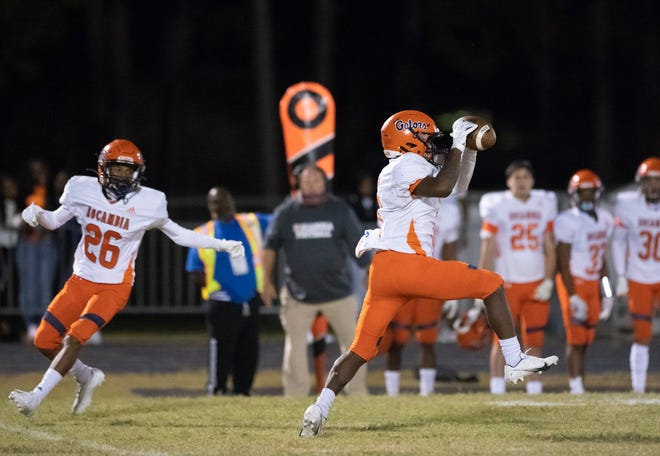 Hershell Jefferson (3) intercepts the ball for a pick-6 and a 21-20 lead after adding the extra point during the Escambia vs Washington football game at Booker T. Washington High School in Pensacola on Friday, Oct. 2, 2020.