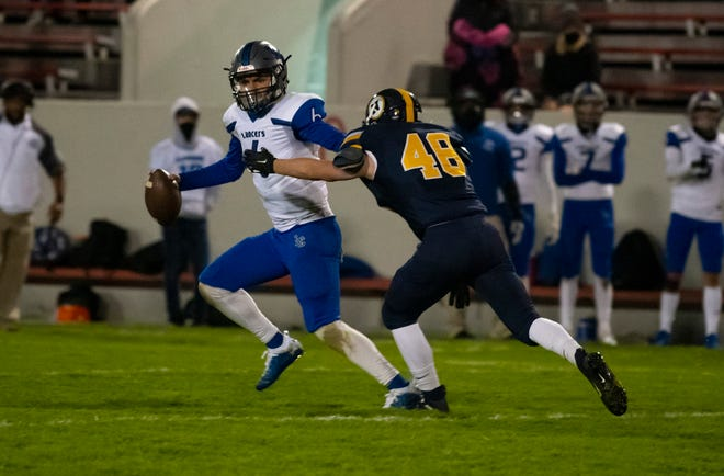 Port Huron Northern's Zach Fretwell puts pressure on L'Anse Creuse's quarterback Isaiah Stansbury for the game ending play Friday, Oct. 2 during their football game against L'Anse Creuse at Memorial Stadium.