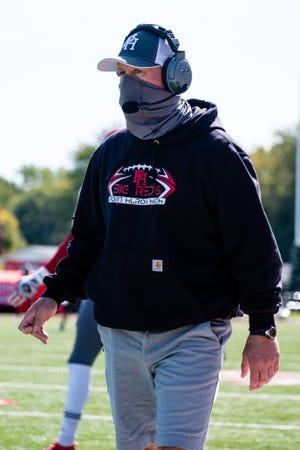 Port Huron head coach Ryan Mullins walks along the sidelines before their game against Lake Shore Saturday, Oct. 3, 2020, at Lake Shore High School.