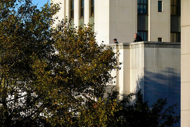 U.S. Secret Service agents stand on a roof before President Donald Trump arrives at Walter Reed National Military Medical Center, in Bethesda, Md., Friday, Oct. 2, 2020, after he tested positive for COVID-19. (AP Photo/Jacquelyn Martin)