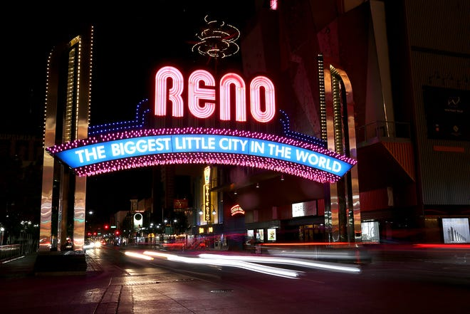 The famous Reno Arch is seen with pink lights for Breast Cancer Awareness Month in October 2020.
