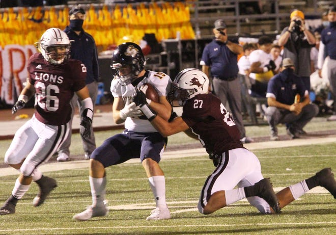 Brownwood High School's Taylor Bessent (27) and Dryden Anderson (26) focus in on a Stephenville ball carrier during a District 5-4A Division I football game at Gordon Wood Stadium Friday Oct. 2, 2020, in Brownwood.