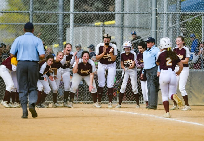 The Harrisburg softball team cheers on Hannah Wagner as she completes a home run during the championship games against Lincoln on Saturday, October 3, at Sherman Park in Sioux Falls.