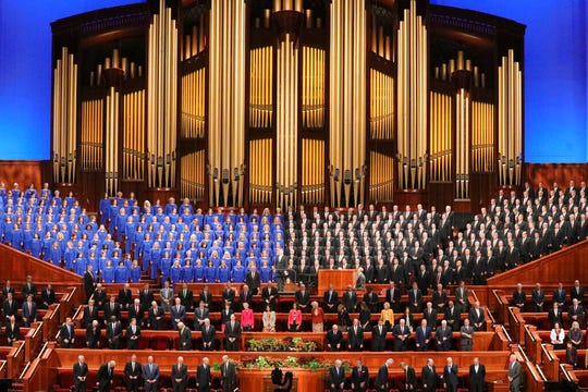 FILE - In this Oct. 5, 2019, file photo, The Tabernacle Choir at Temple Square perform during The Church of Jesus Christ of Latter-day Saints' twice-annual church conference in Salt Lake City. The annual Christmas concert by the choir has been cancelled because of lingering concerns about the coronavirus pandemic. The cancellation of the Tabernacle Choir at Temple Square's holiday concert announced Friday, Aug. 21, 2020, by church officials is the latest sign that disruptions to normal religious activity will continue through the holidays. (AP Photo/Rick Bowmer, File)