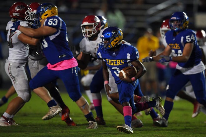 Martin County High School's Denzel Alexander makes a quick cut up the field on Friday, Oct. 2, 2020, during a game against Vero Beach High School in Stuart. Vero Beach won the game 40-3.
