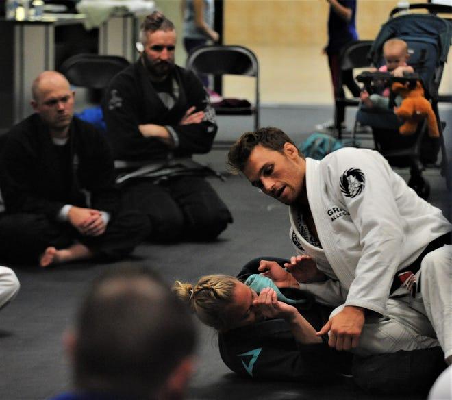 Clark Gracie, grandson of Carlos Gracie, the founder of Gracie Jiu Jitsu, provides instruction during Saturday's session at Gracie Allegiance Jiu Jitsu Academy at Colony Square Mall.