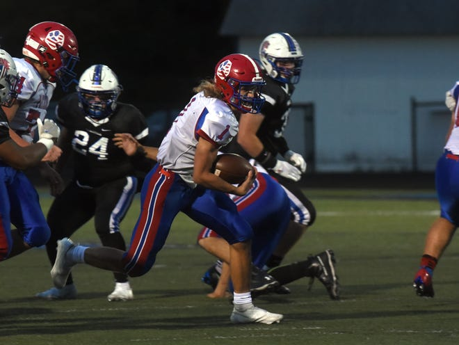Licking Valley quarterback Cameron Parmer breaks through the middle of the Zanesville defense during the first half of a 24-0 win on Friday night at John D. Sulsberger Memorial Stadium. Parmer ran for a team-high 102 yards on 17 carries, including two touchdowns.
