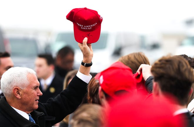 Vice President Mike Pence signs supporters Make America Great Again hats on Wednesday, Nov. 20, 2019, at Austin Straubel International Airport in Green Bay, Wis.