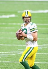 The Packers' Aaron Rodgers, here against the Saints, is just about the hottest QB in the league right now. It helps that a strong running game is opening things up for him.