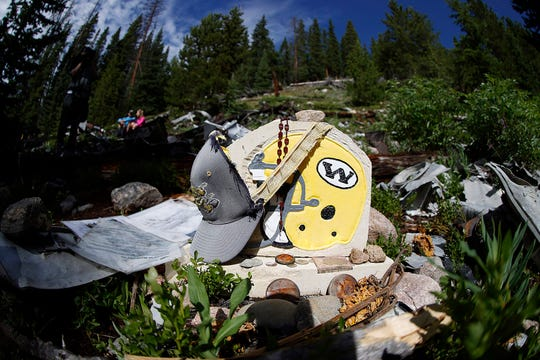 Fifty years after a plane carrying members of the Wichita State football team crashed in Colorado, wreckage is still scattered on the mountaintop.