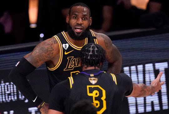 LeBron James and Anthony Davis exchanged some heated words about missed defensive assignments in Game 2.