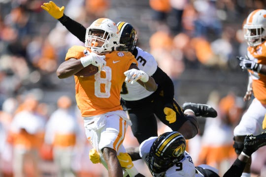 Tennessee running back Ty Chandler runs the ball as Missouri safeties Martez Manuel (3) and Tyree Gillespie try to stop him.