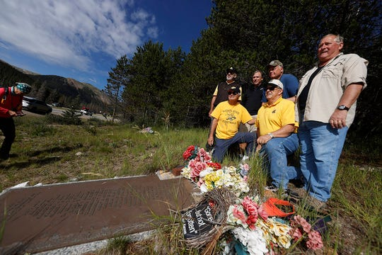 Members of the 1970 Wichita State football team  gathered at the site of the 1970 plane crash, near a memorial for their teammates who died.