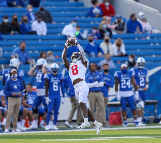 Mississippi wide receiver Elijah Moore catches a ball in the first half against Kentucky at Kroger Field.