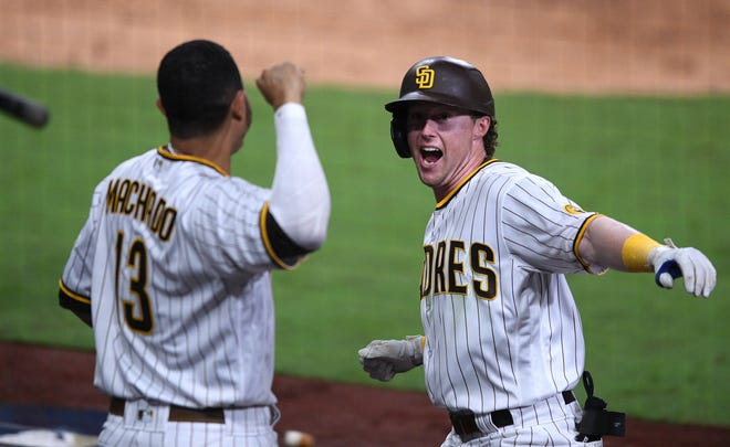 Padres-Cardinals, Game 3: Jake Cronenworth celebrates his eight-inning home run.