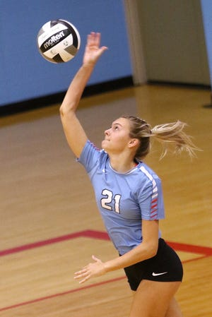 Alliance's Reese Grisez hits a serve against Lake during a game in October 2020.