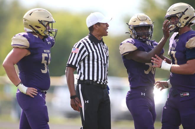 Referee Reggie Smith explains a call during Western Beaver's game against Ligonier Valley in Week 3. Smith, a New Brighton native and college referee, is working high school games while the Big Ten prepares to resume play.