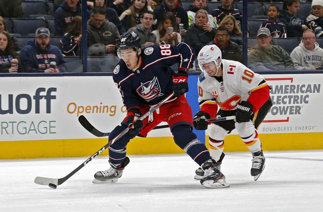 Columbus Blue Jackets right wing Kole Sherwood (88) skates into the zone with the puck against Calgary Flames center Derek Ryan (10) in the 1st period of their game at Nationwide Arena in Columbus, Ohio on November 2, 2019. [Kyle Robertson/Dispatch]