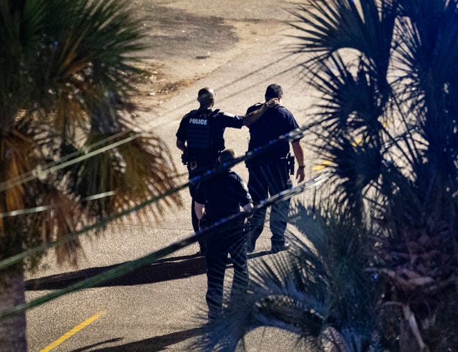 Police officers work near the site of a shooting in Myrtle Beach, S.C., on Saturday.  A South Carolina police chief announced early Sunday the death of an officer following a shooting in Myrtle Beach. Officer Jacob Hancher was killed while responding to a call for service late Saturday, Myrtle Beach Chief Amy Prock said at a news conference.