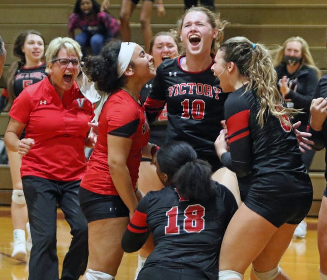 Victory Cristian's Jaiden Almon (10) celebrates the Storm's victory over George Jenkins in the championship match of the 2020 Oktoberfest Volleyball Showcase as, from left, head coach Laura Romeo, Jossy Rodriguez (8), Damyah Joyner (18) and Alaina Fountain join in.