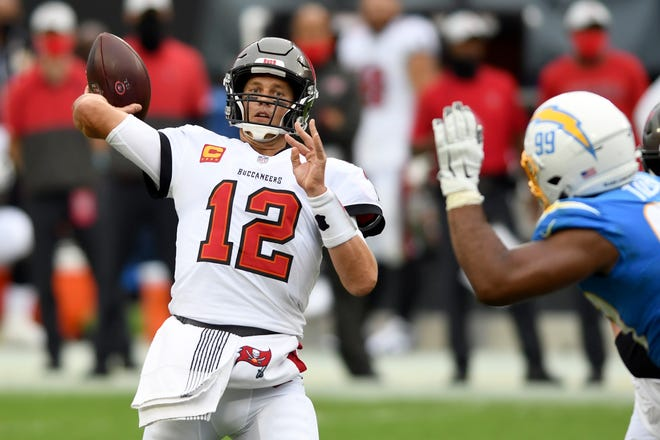 Tampa Bay Buccaneers quarterback Tom Brady (12) throws a pass as he is pressured by Los Angeles Chargers defensive tackle Jerry Tillery (99) during the first half Sunday in Tampa