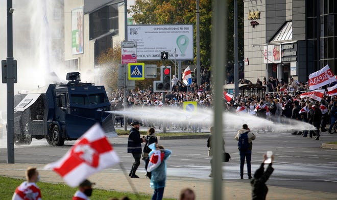 Police use a water cannon against demonstrators during a rally in Minsk, Belarus, on Sunday. Hundreds of thousands of Belarusians have been protesting daily since the Aug. 9 presidential election.