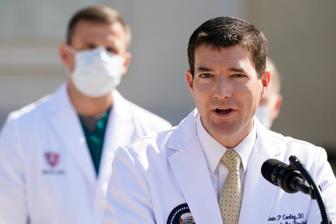 Dr. Sean Conley, physician to President Donald Trump, briefs reporters at Walter Reed National Military Medical Center in Bethesda, Md., on Sunday. Trump was admitted to the hospital after contracting the coronavirus.