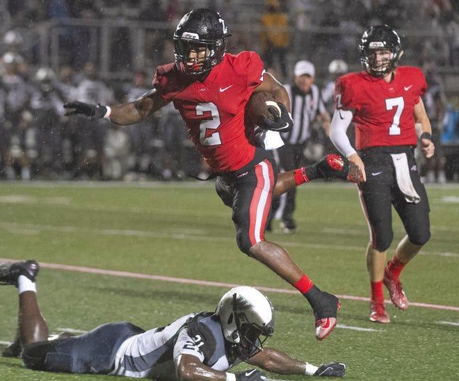 Southeastern University running back Bryan Bell (2) leaps over Webber University defensive lineman Devonte Harris (21) during the first half at Victory Field in Lakeland last week.