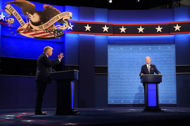 President Donald Trump, left, and former Vice President Joe Biden participate in the first presidential debate Tuesday, Sept. 29, at Case Western University and Cleveland Clinic, in Cleveland, Ohio.