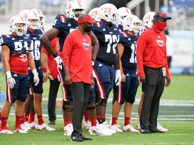 Florida Atlantic head coach Willie Taggart is shown with his players before a 21-17 win over Charlotte on Oct. 3. Taggart said 18 players and nine staff members tested positive for COVID-19 last week, leading to the postponement of the Southern Miss game.