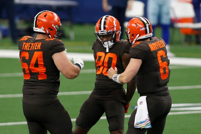 Oct 4, 2020; Arlington, Texas, USA; Cleveland Browns wide receiver Jarvis Landry (80) and quarterback Baker Mayfield (6) and center JC Tretter (64) celebrate a touchdown in the first quarter against the Dallas Cowboys  at AT&T Stadium. Mandatory Credit: Tim Heitman-USA TODAY Sports